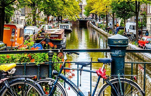 Verhuizen naar Amsterdam Den Haag Rotterdam terugkeren naar Nederland internationale verhuizing groepage diensten